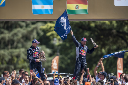 Stephane Peterhansel (FRA) of Team Peugeot-Total celebrates at the podium of Rally Dakar 2016 in Rosario, Argentina on January 16th, 2016