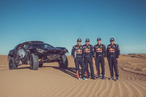 Sebastien Loeb, Daniel Elena, Carlos Sainz and Lucas Cruz pose for a portrait during the Peugeot test in Erfoud, Morocco on September 16, 2015